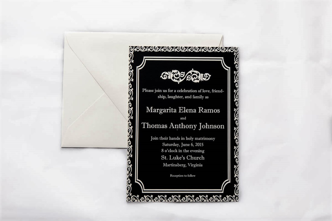 Black with ivory border and text wedding invitation with gray envelope.