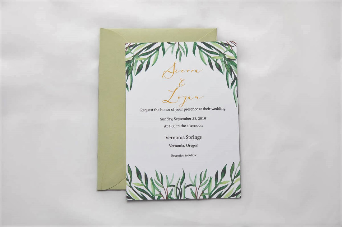 Leaf wedding invitation with names in gold font and matching sage envelope.