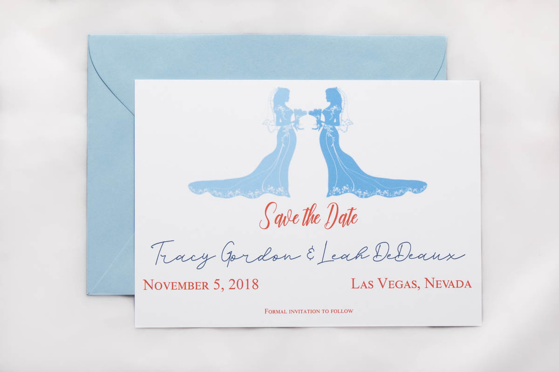 LGBTQIA save the date with two brides in light blue and light blue envelope