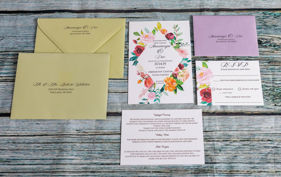 Floral diamond frame wedding invitation with an RSVP card, addressed lavender RSVP envelope, details insert card, and sage guest envelope with guest addressing and return address on the back flap.