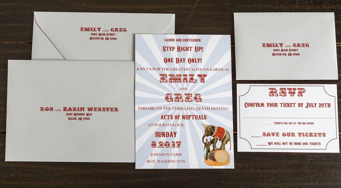 Gray and maroon/dark red circus theme wedding invitation with a ticket RSVP and addressed envelope along with a guest addressed envelope with return addressing on the back flap.
