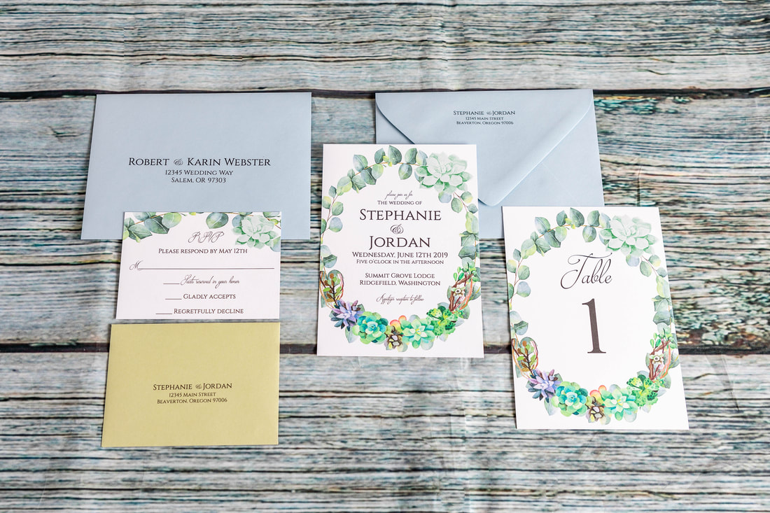 Succulent and eucalyptus wedding invitation with RSVP card and matching sage RSVP envelope, table number with matching frame from invitation.  Baby blue guest envelope with guest addressing and return addressing on back flap.