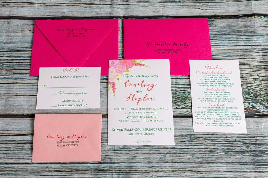 Pink flowers in the corner of the wedding invitation, RSVP card with RSVP envelope with address, directions insert card, fuschia guest envelope with guest address and return address on the back flap.