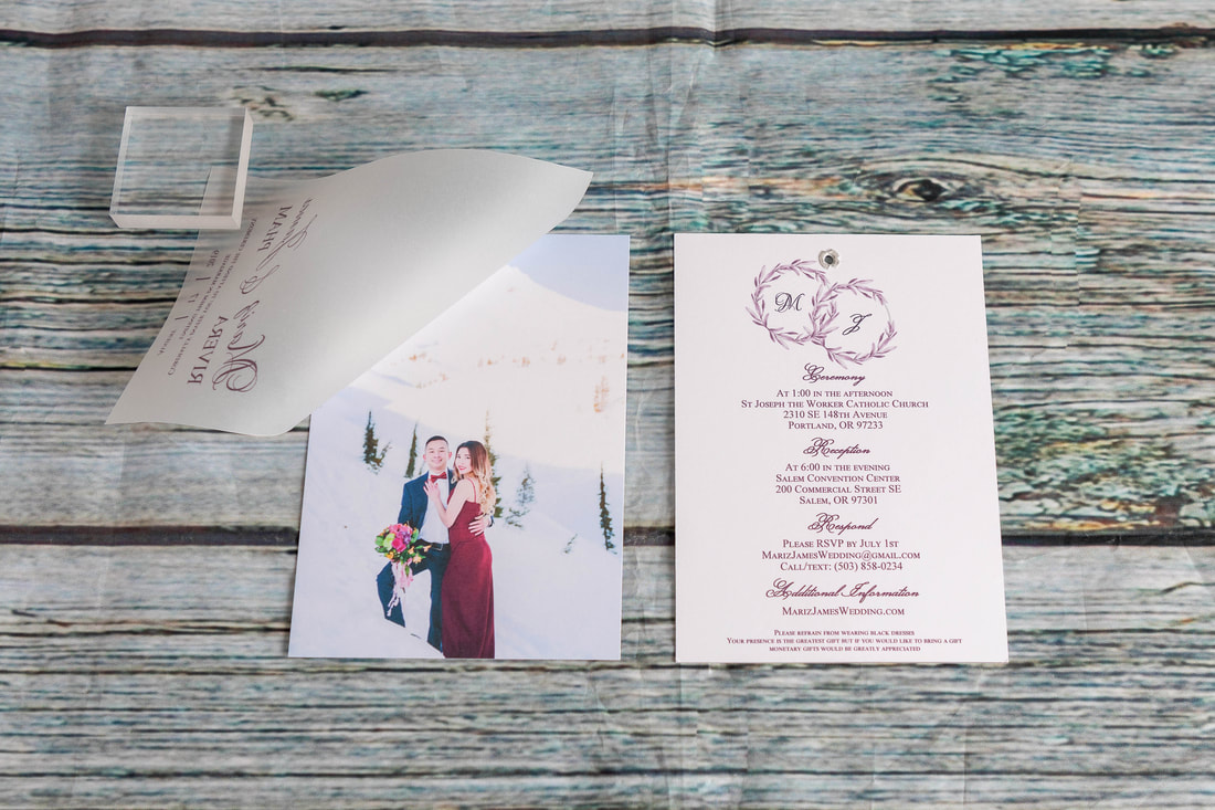 Layered wedding invitation with vellum over photo and information printed on back. Vellum attached to card.