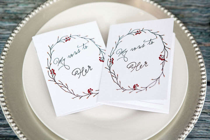 Vow booklets with a frame of twigs and berries.