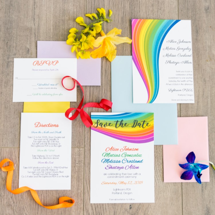 Polyamorous wedding stationery including save the date, invitation, RSVP card, directions card and envelopes.  Design on the cards has rainbows as a symbol for the LGBTQIA community.