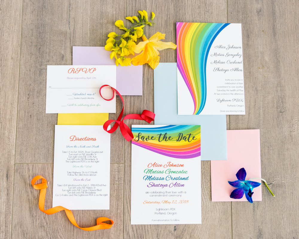 LGBTQIA wedding invitation suite with rainbow save the date, rainbow wedding invitation, insert card, RSVP card and matching envelopes.