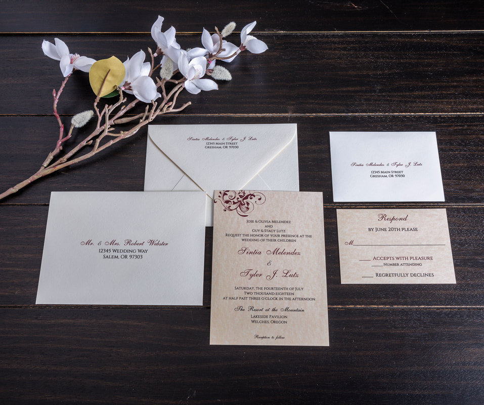 Parchment wedding invitation with a maroon flourish in the corner. Matching RSVP with white RSVP envelope with address printed on it.  Guest address and return address on the guest envelope.